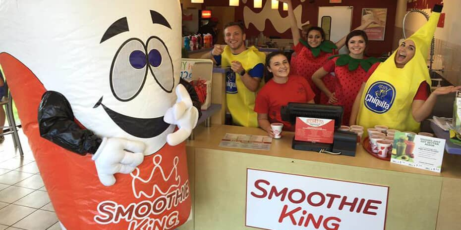Smoothie King smoothie mascot and employees dressed as bananas and strawberries