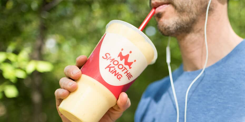 Man drinking Smoothie King smoothie after workout