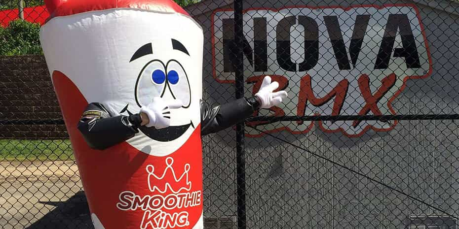 smoothie king mascot in front of nova bmx