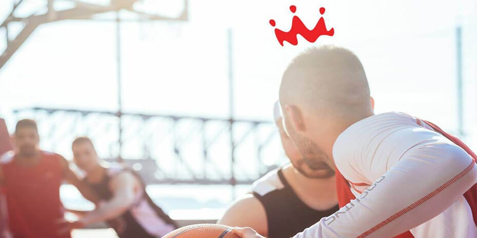 men playing basketball with smoothie king crown