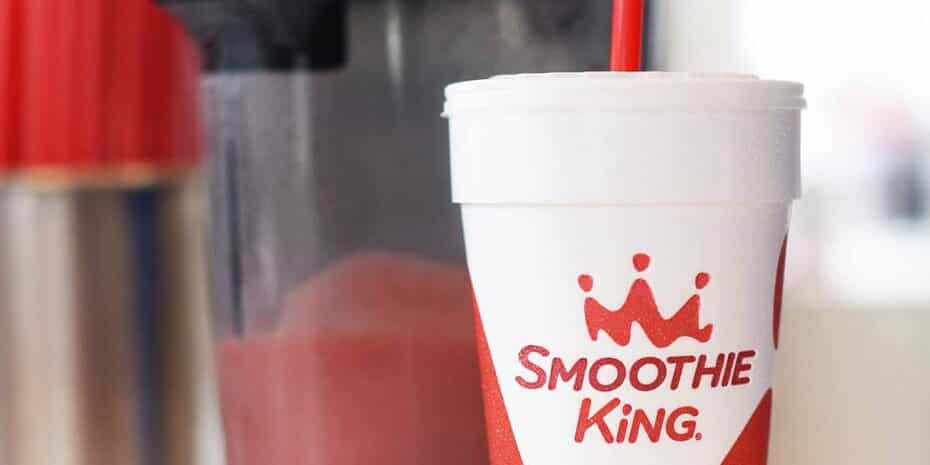 smoothie king smoothie in front of blender