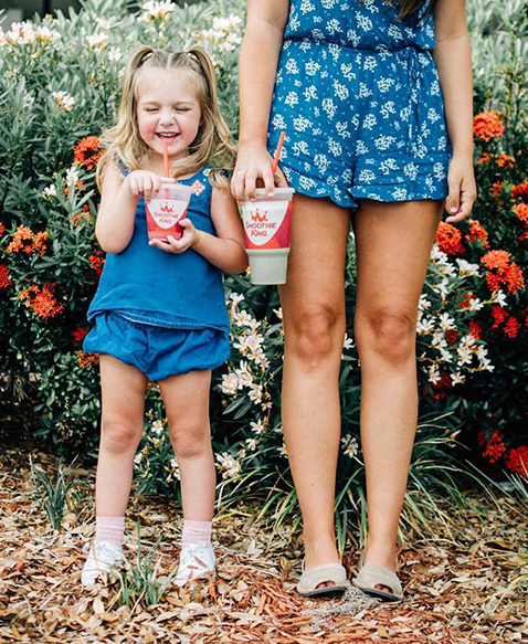 Mother and Daughter drinking Smoothie King Smoothies